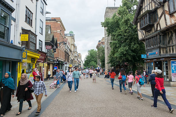 People walking, shopping around city of Oxford stock photo