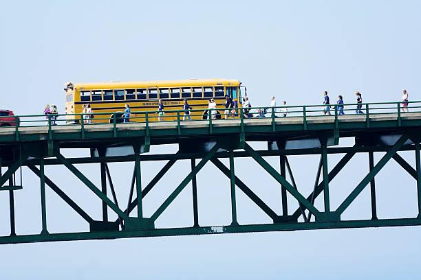 people walking the mackinac bridge - memorial day weekend stock pictures, royalty-free photos & images