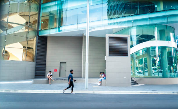 People walking the streets outside of the University of Technology Sydney. stock photo