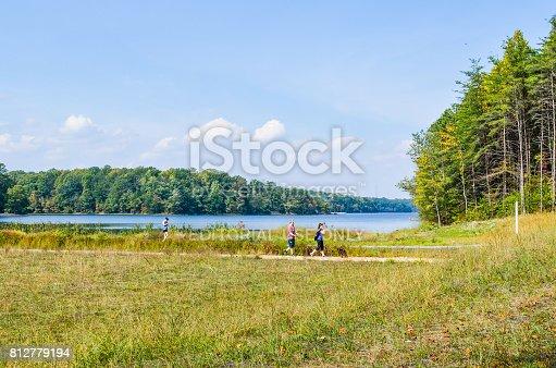 istock People walking their dogs on trail in Burke Lake Park in Virginia 812779194