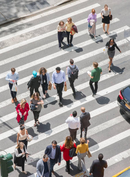 People Walking Through a Zebra Crossing Area