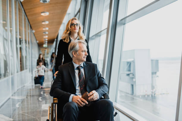 people walking through airport - leaving partnership corporate business sitting stock photos and pictures