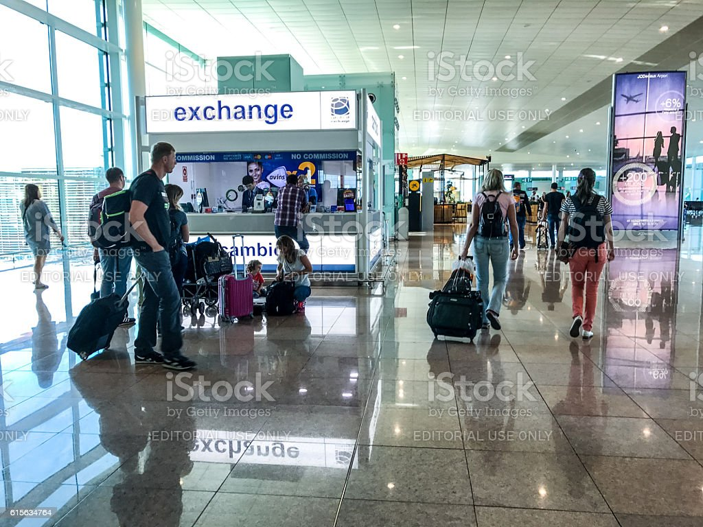 People walking through El Prat Airport, Barcelona stock photo