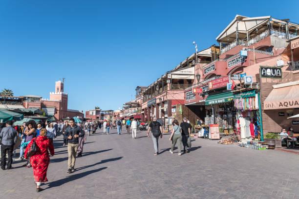 People walking through Jemma el-Fna Square in Marrakesh stock photo
