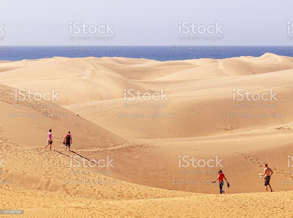 People walking through Sand Dune to beach (Gran Canaria) stock photo