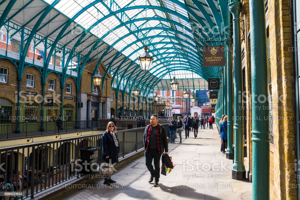People Walking Through Shopping Arcade In Covent Garden London Uk Stock  Photo - Download Image Now