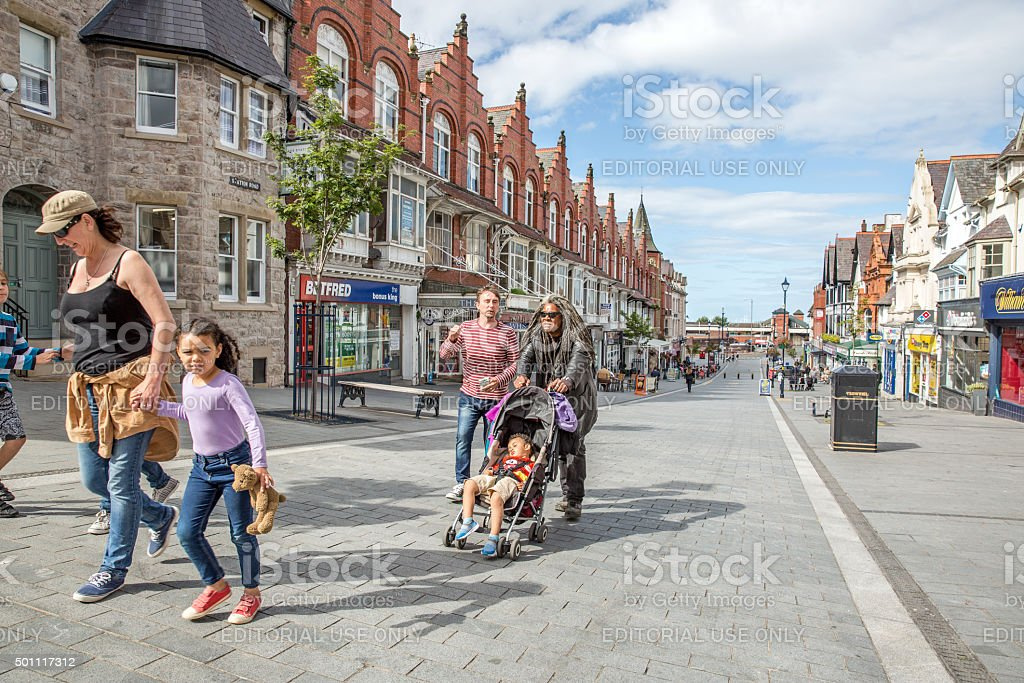 People walking through town centre in Colwyn Bay stock photo
