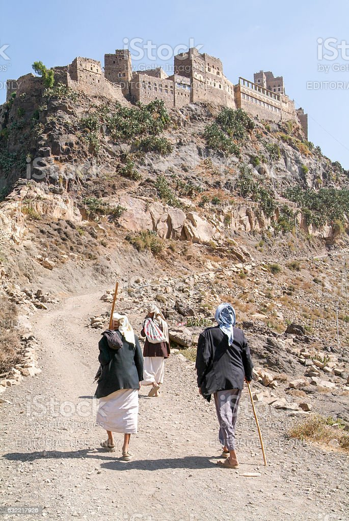 People walking to a village on Haraz mountains, Yemen stock photo