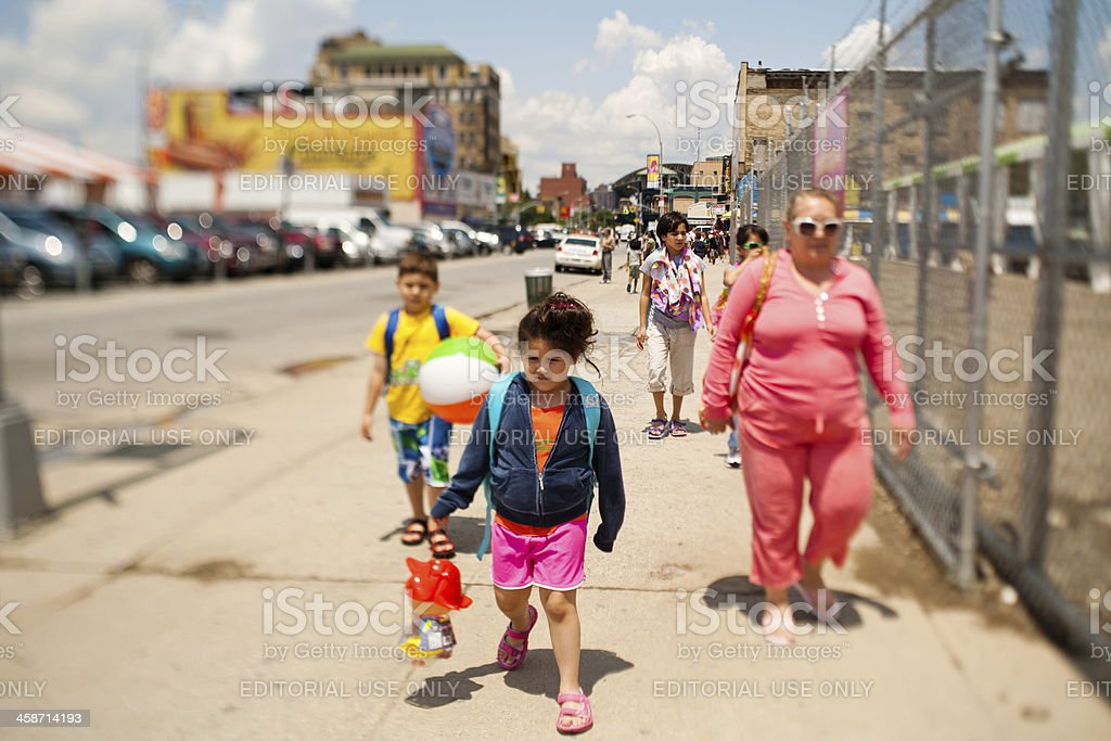 People walking to Coney Island stock photo