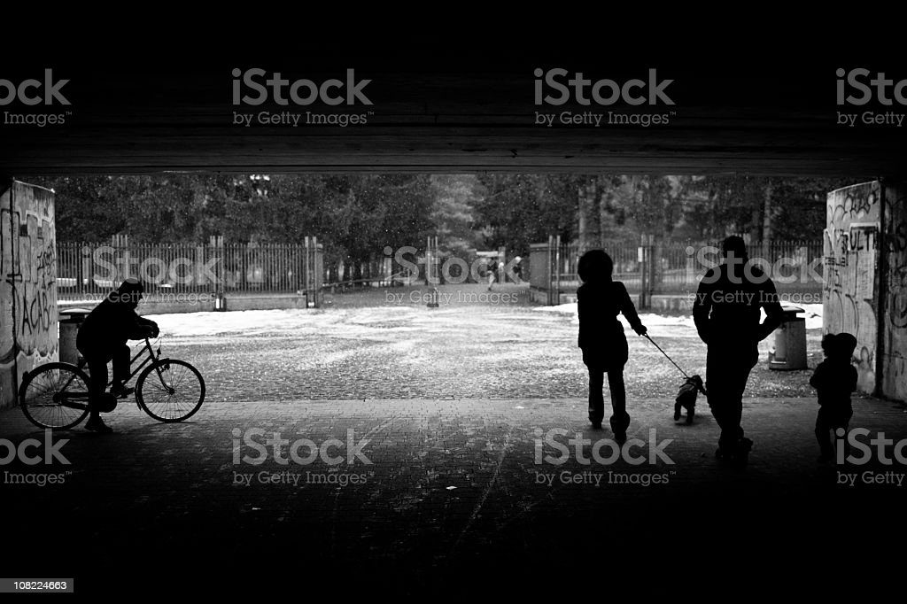 People Walking Under Tunnel to Park. Black and White stock photo