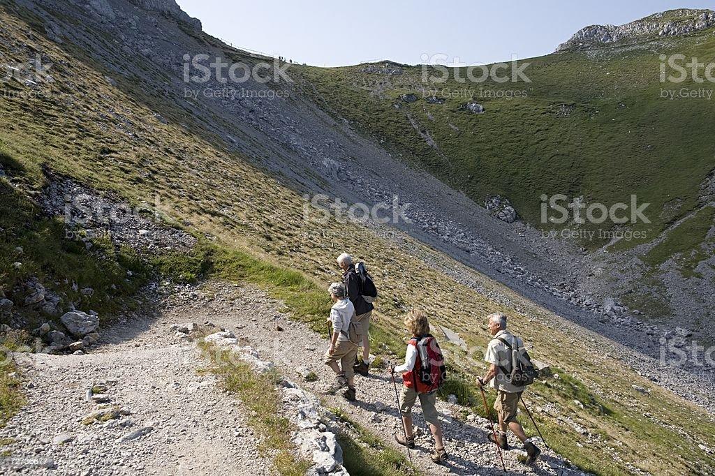 People walking up mountain royalty-free stock photo