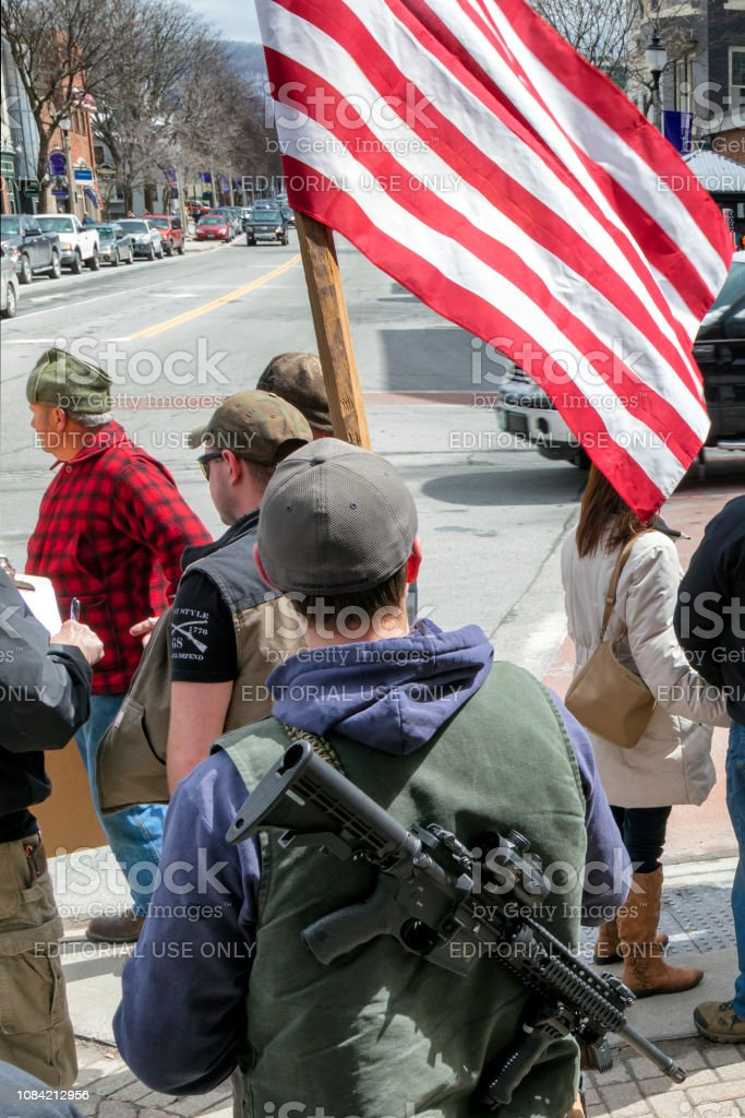 People Walking with Guns in Downtown of Bennington, Vermont, United States stock photo
