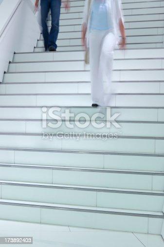 171150458 istock photo People Walkinng Down Stairs 173892403