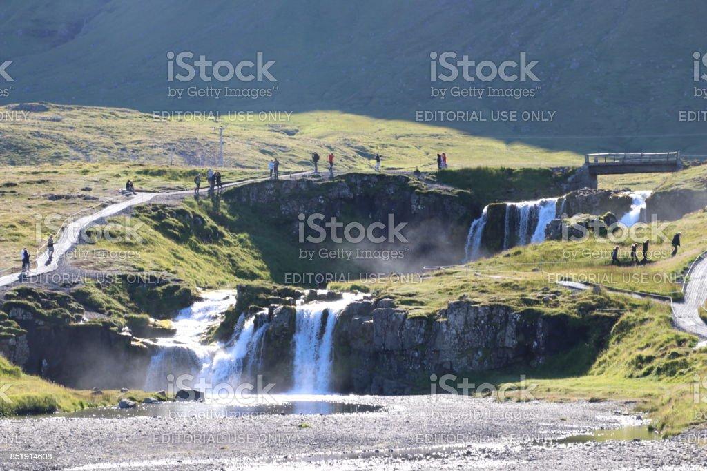 People walks around the waterfall of Kirkjufell (Iceland) stock photo
