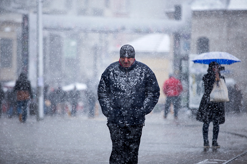 People walks in Istiklal Street under heavy snow in istanbul