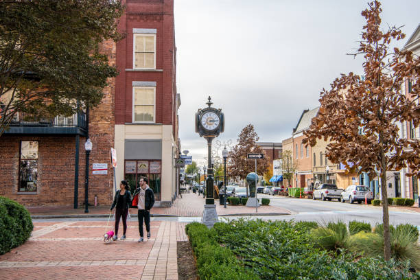 People wander the charming Main Street area downtown Spartanburg Spartanburg, S.C. / USA - November 16, 2019: People wander the charming Main Street area downtown. Spartanburg is very scenic. spartanburg stock pictures, royalty-free photos & images