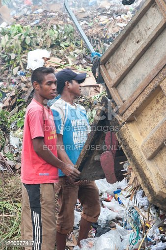 Dili Timor Leste on March 25, 2011: A people was working at final disposal