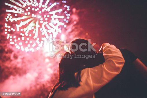 People watch and record fireworks