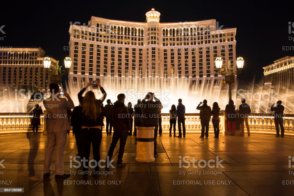People watch the fountain show at the Bellagio Hotel in Las Vegas Nevada stock photo
