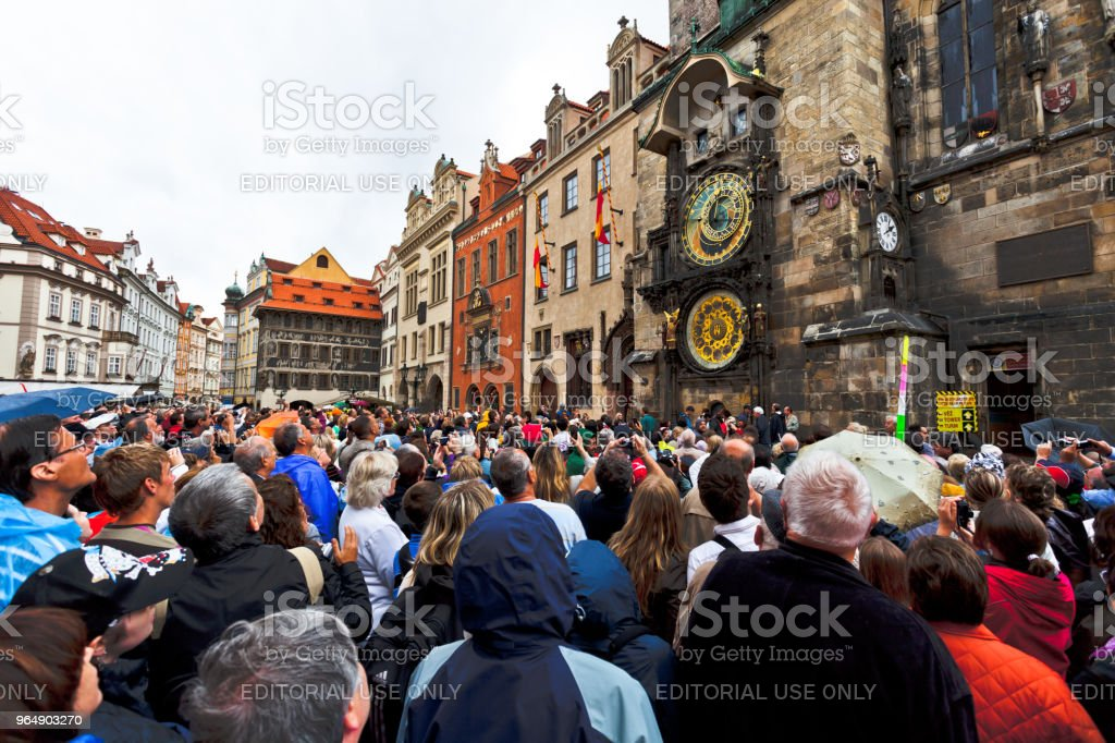 People watch the performance on an astronomical clock. royalty-free stock photo