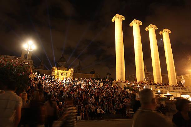 People watching Magic Fountain in Barcelona stock photo