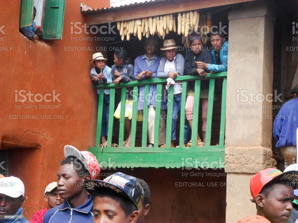 People watching Malagasy traditional musicians playing folk music during the rite of 'famadihana' (exhumation) in the highlands stock photo