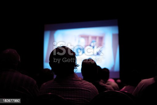 istock People watching movie in dark cinema 182677992