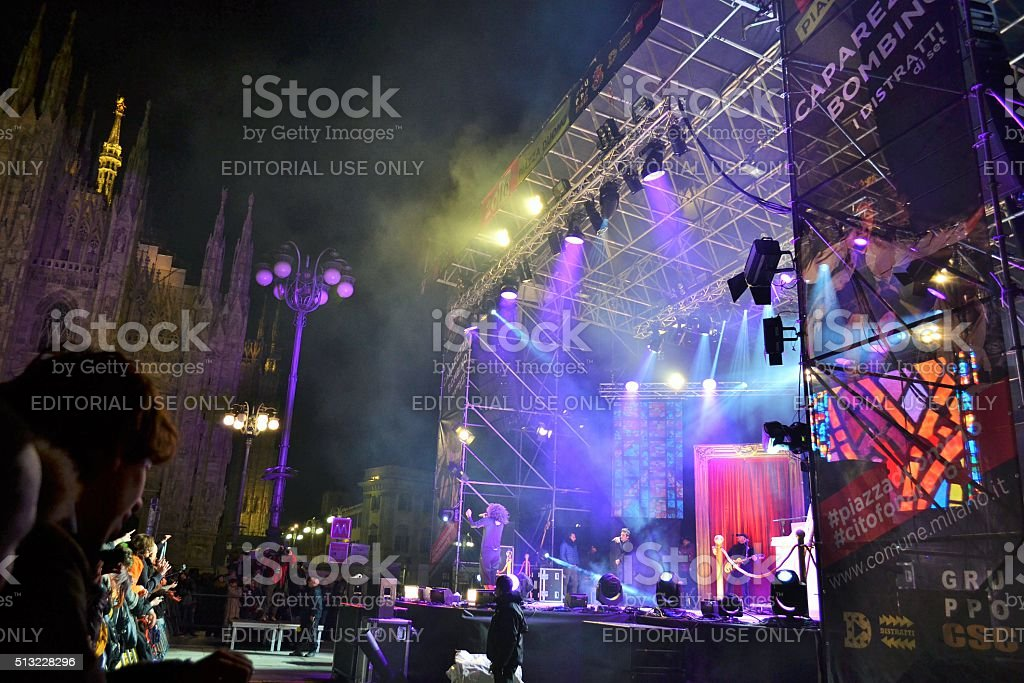 People watching New Year concert by night in Milan. stock photo