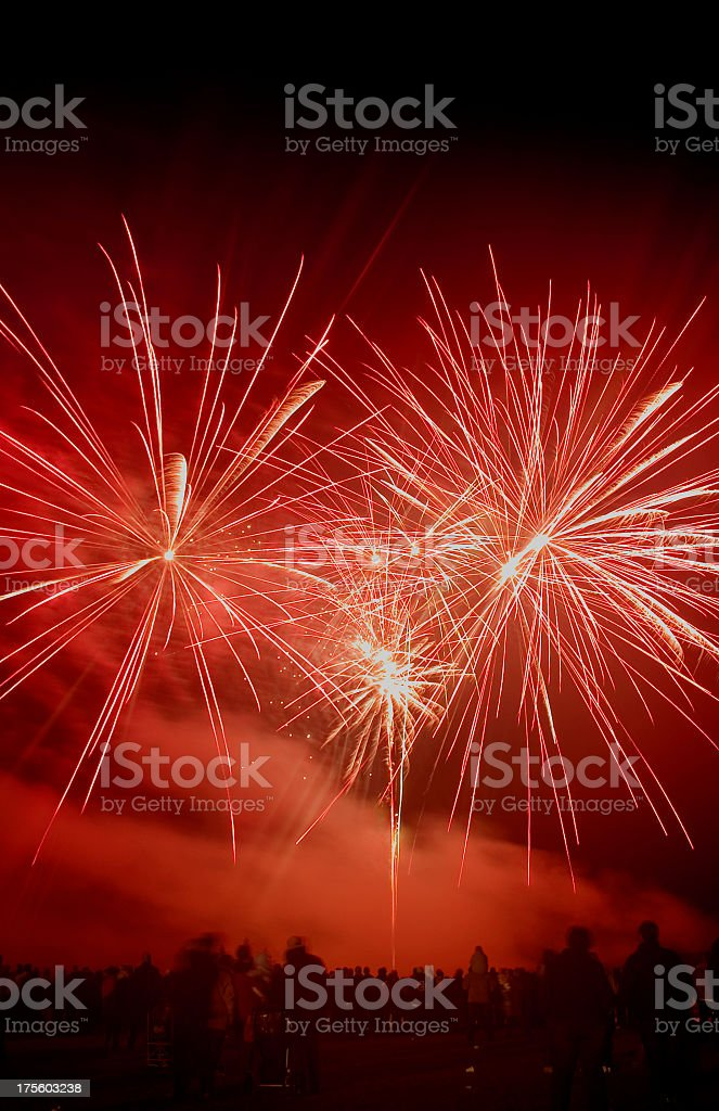 People watching red fireworks on the sky royalty-free stock photo