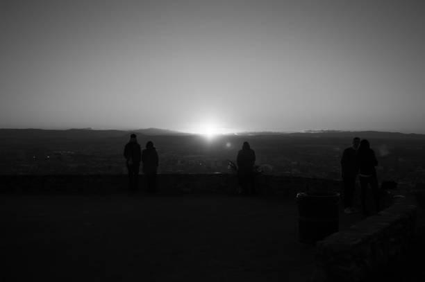 People Watching Sunset at Mirador del Barranco del Abogado Lookout in Granada, Spain stock photo