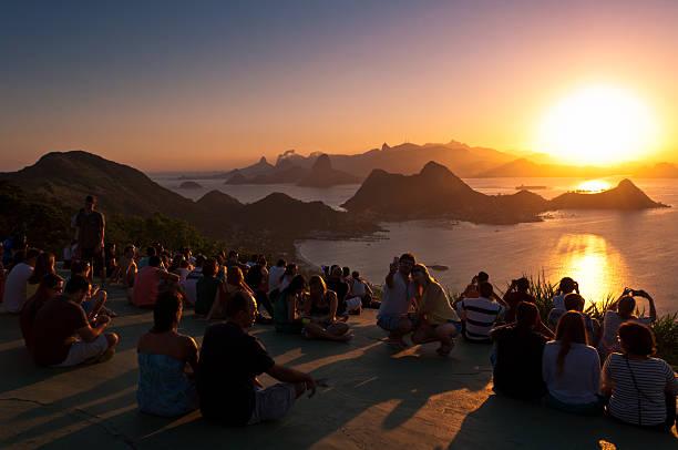 People Watching Sunset in Rio de Janeiro from Niteroi stock photo