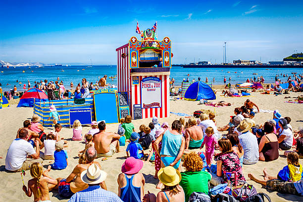 people watching the punch and judy show at weymouth, uk - weymouth stock photos and pictures