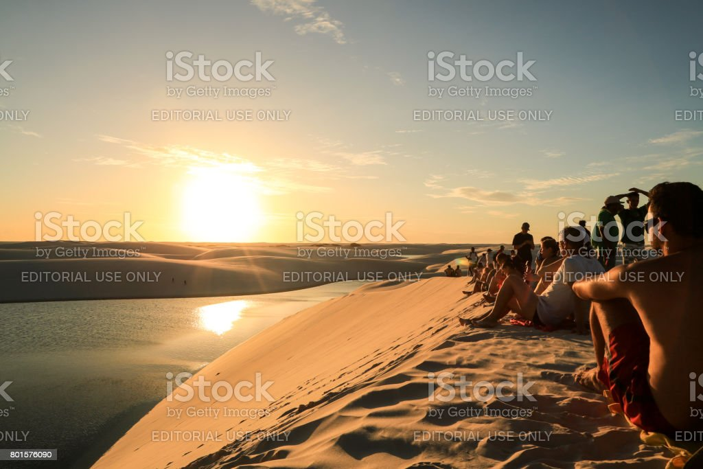 People watching the sunset stock photo