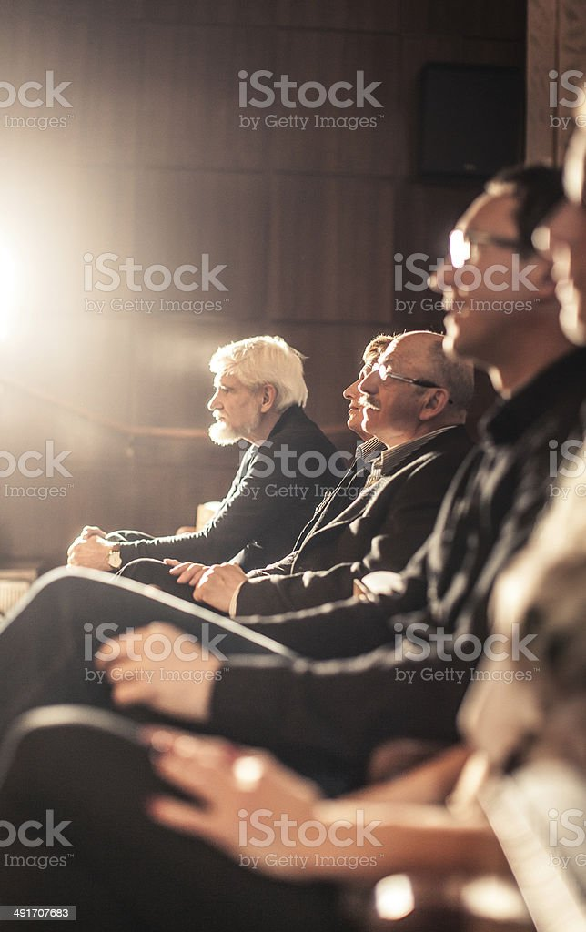 People watching theatre show stock photo
