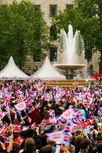 people waving british flags at royal wedding of prince william and kate middleton, london, uk - matrimonio reale foto e immagini stock