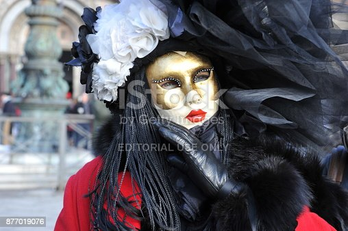 istock people wear black and red costume in Carnival of Venice, Italy. February 12, 2013 877019076