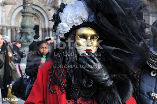 istock people wear black and red costume in Carnival of Venice, Italy. February 12, 2013 877019384