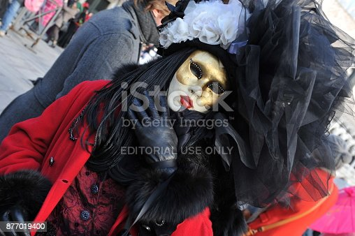 istock people wear black and red costume in Carnival of Venice, Italy. February 12, 2013 877019400