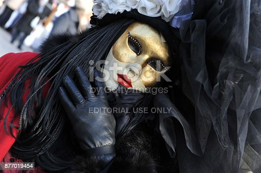istock people wear black and red costume in Carnival of Venice, Italy. February 12, 2013 877019454