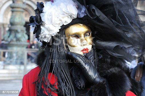 istock people wear black and red costume in Carnival of Venice, Italy. February 12, 2013 877019538