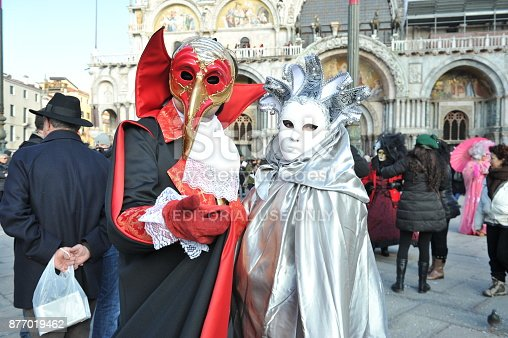 istock people wear black and red costume in Carnival of Venice, Italy. Feb 12, 2013 877019462