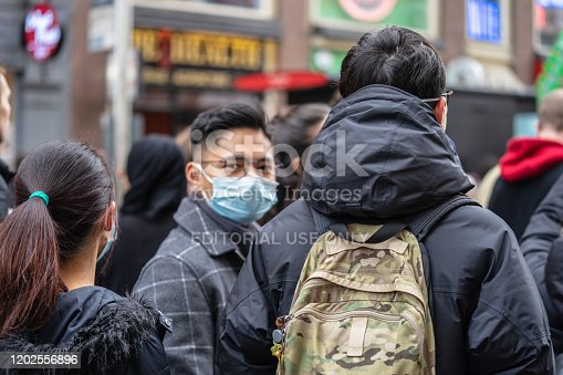 1202557009istockphoto People wearing a face masks to protecting themself because of epidemic in China. Selective Focus. Concept of coronavirus quarantine. 1202556896