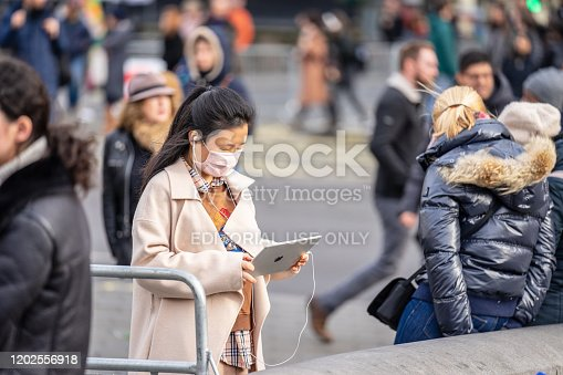1202557009istockphoto People wearing a face masks to protecting themself because of epidemic in China. Selective Focus. Concept of coronavirus quarantine. 1202556918