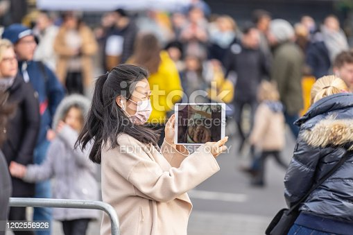 1202557009istockphoto People wearing a face masks to protecting themself because of epidemic in China. Selective Focus. Concept of coronavirus quarantine. 1202556926