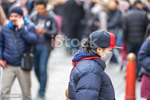 1202557009istockphoto People wearing a face masks to protecting themself because of epidemic in China. Selective Focus. Concept of coronavirus quarantine. 1202556931