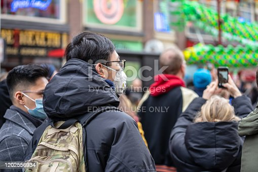 1202557009istockphoto People wearing a face masks to protecting themself because of epidemic in China. Selective Focus. Concept of coronavirus quarantine. 1202556934
