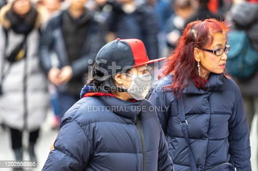 1202557009istockphoto People wearing a face masks to protecting themself because of epidemic in China. Selective Focus. Concept of coronavirus quarantine. 1202556955