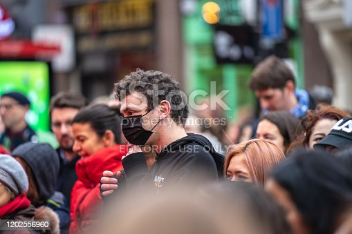 1202557009istockphoto People wearing a face masks to protecting themself because of epidemic in China. Selective Focus. Concept of coronavirus quarantine. 1202556960