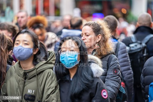 1202557009istockphoto People wearing a face masks to protecting themself because of epidemic in China. Selective Focus. Concept of coronavirus quarantine. 1202556961
