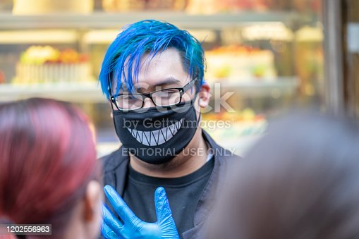 1202557009istockphoto People wearing a face masks to protecting themself because of epidemic in China. Selective Focus. Concept of coronavirus quarantine. 1202556963
